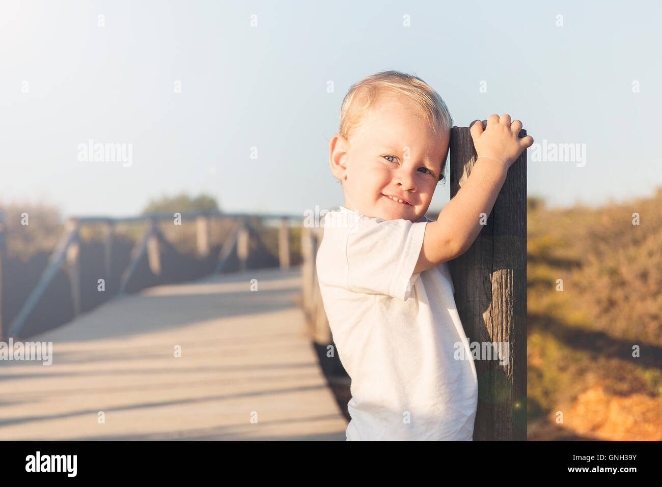 Portrait of a smiling boy on beach - Stock Image