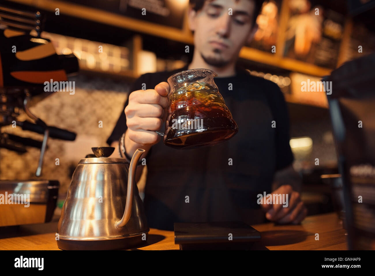 Barista at work in a coffee shop - Stock Image