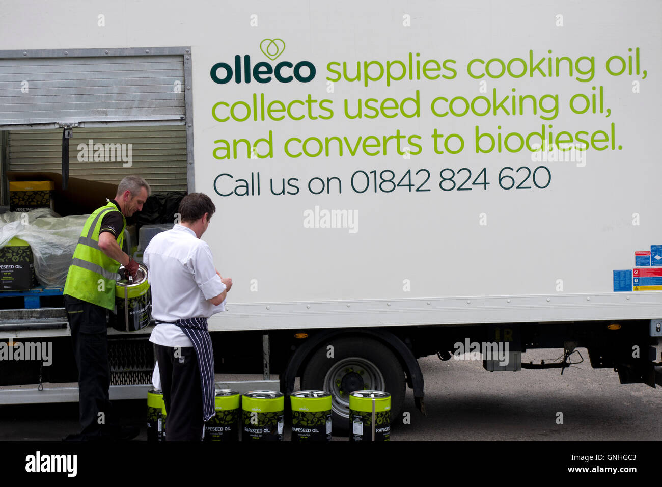 delivery of drums of rapeseed oil for restaurant kitchen by olleco van who also collect used oil for biofuel conversion - Stock Image