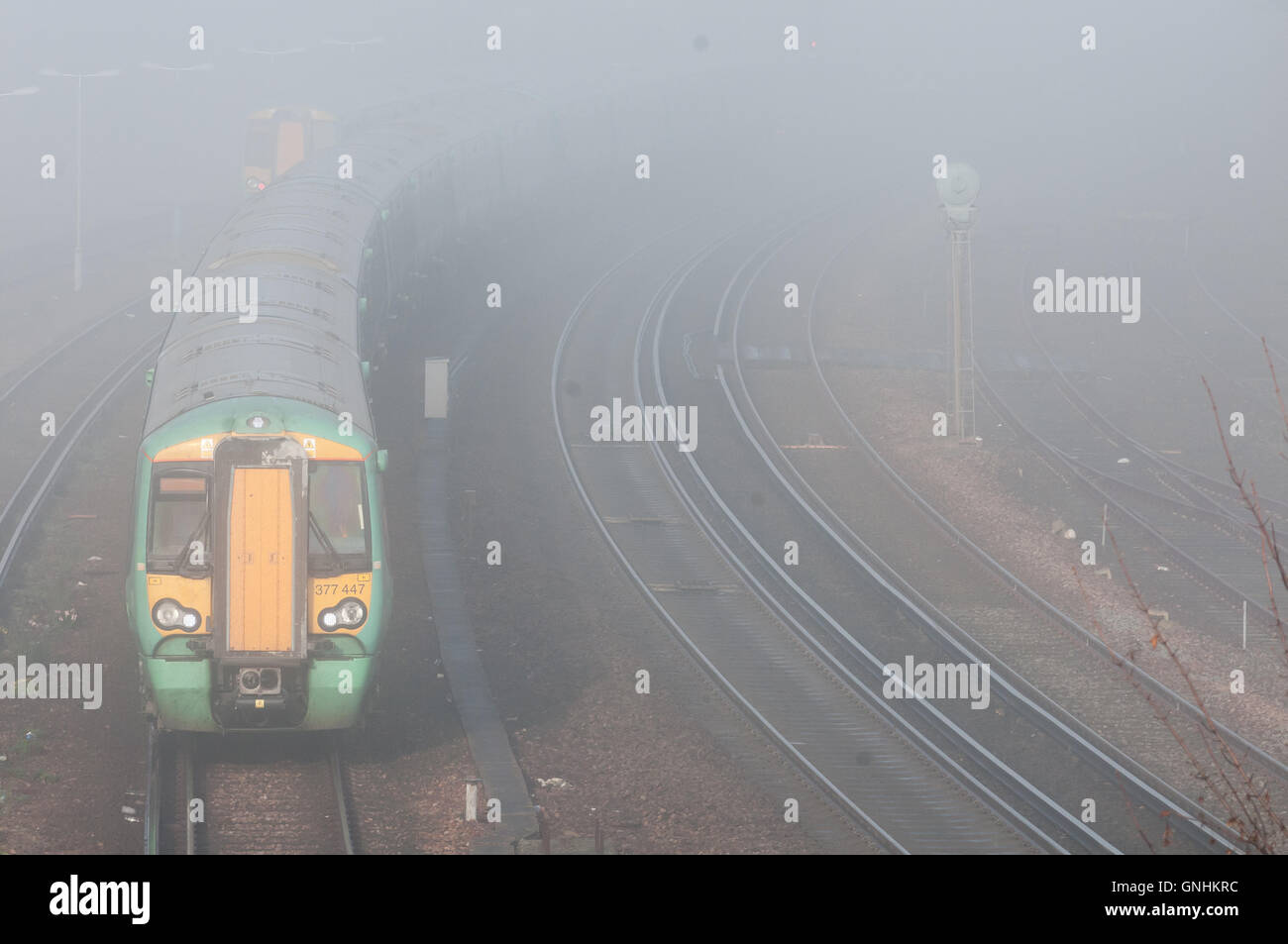 Trains struggling through a foggy morning - Stock Image