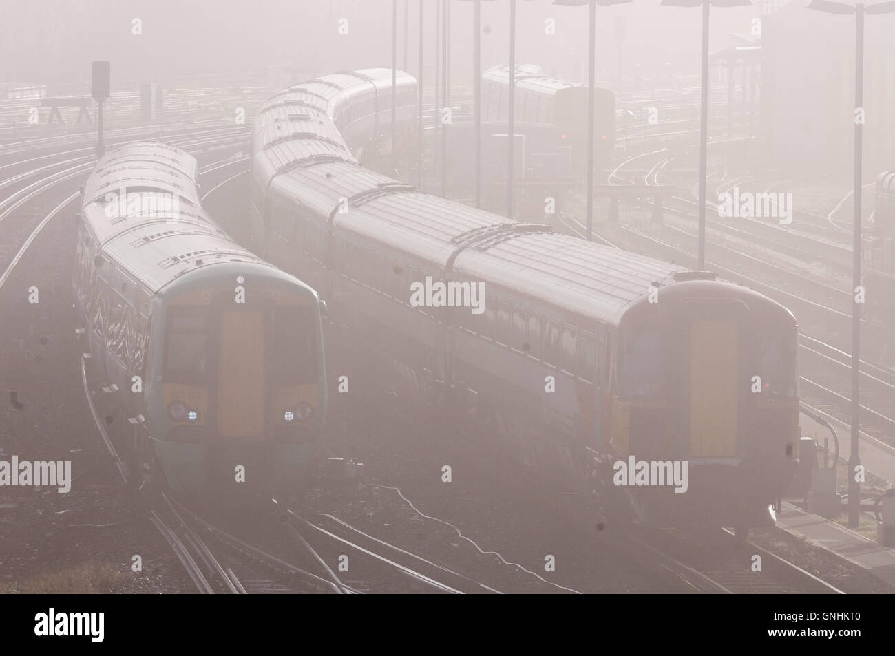 Trains struggling through a foggy morning Stock Photo