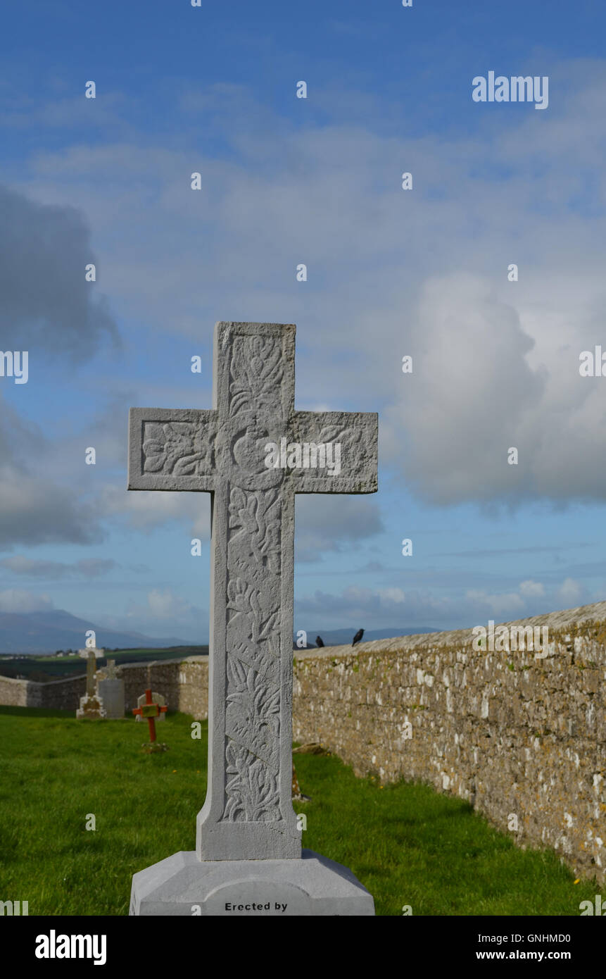 Old graveyard marked by a stone cross in Cashel. - Stock Image