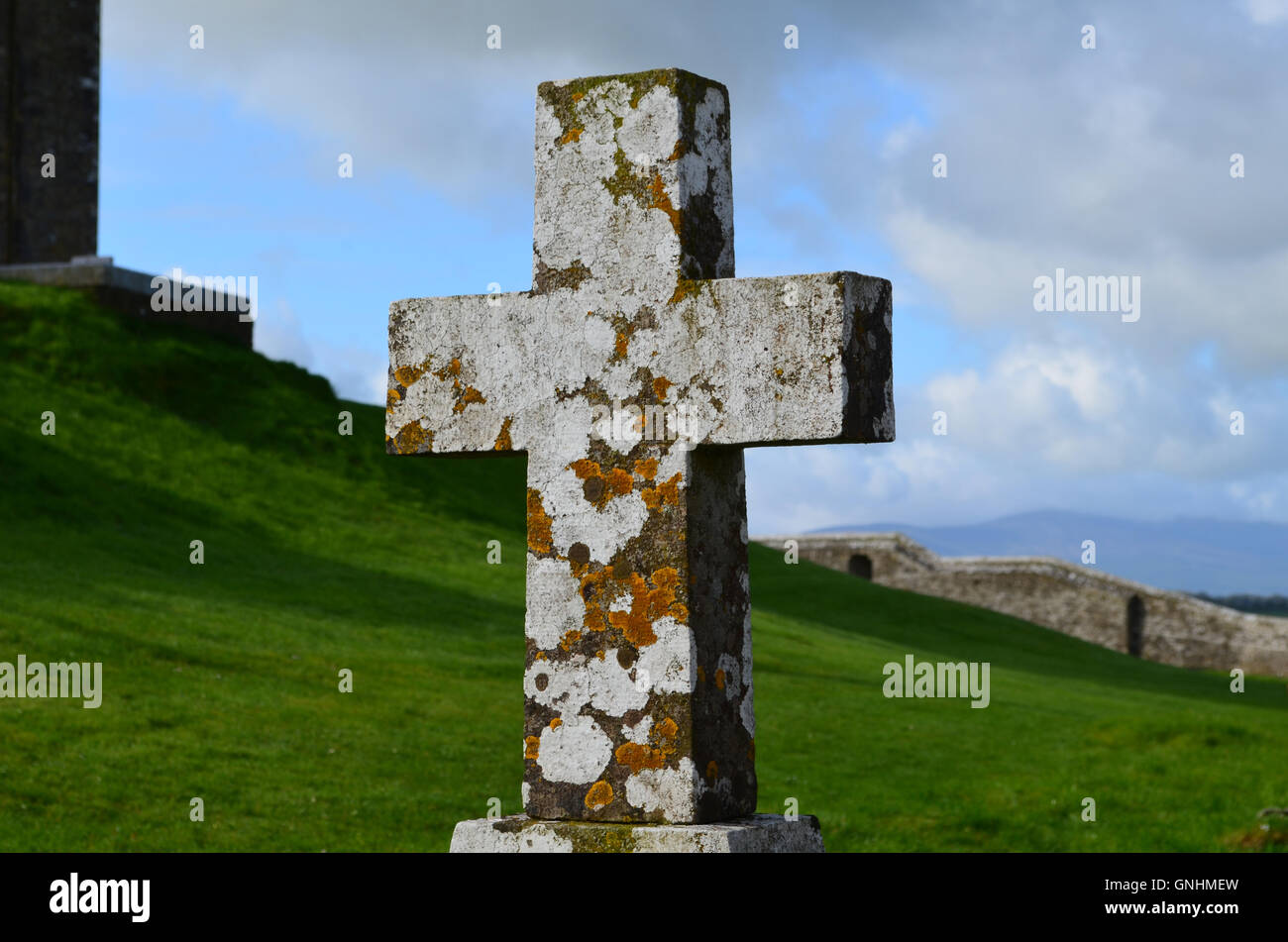 Old stone cross in Ireland with lichen growing on it in Ireland. Stock Photo