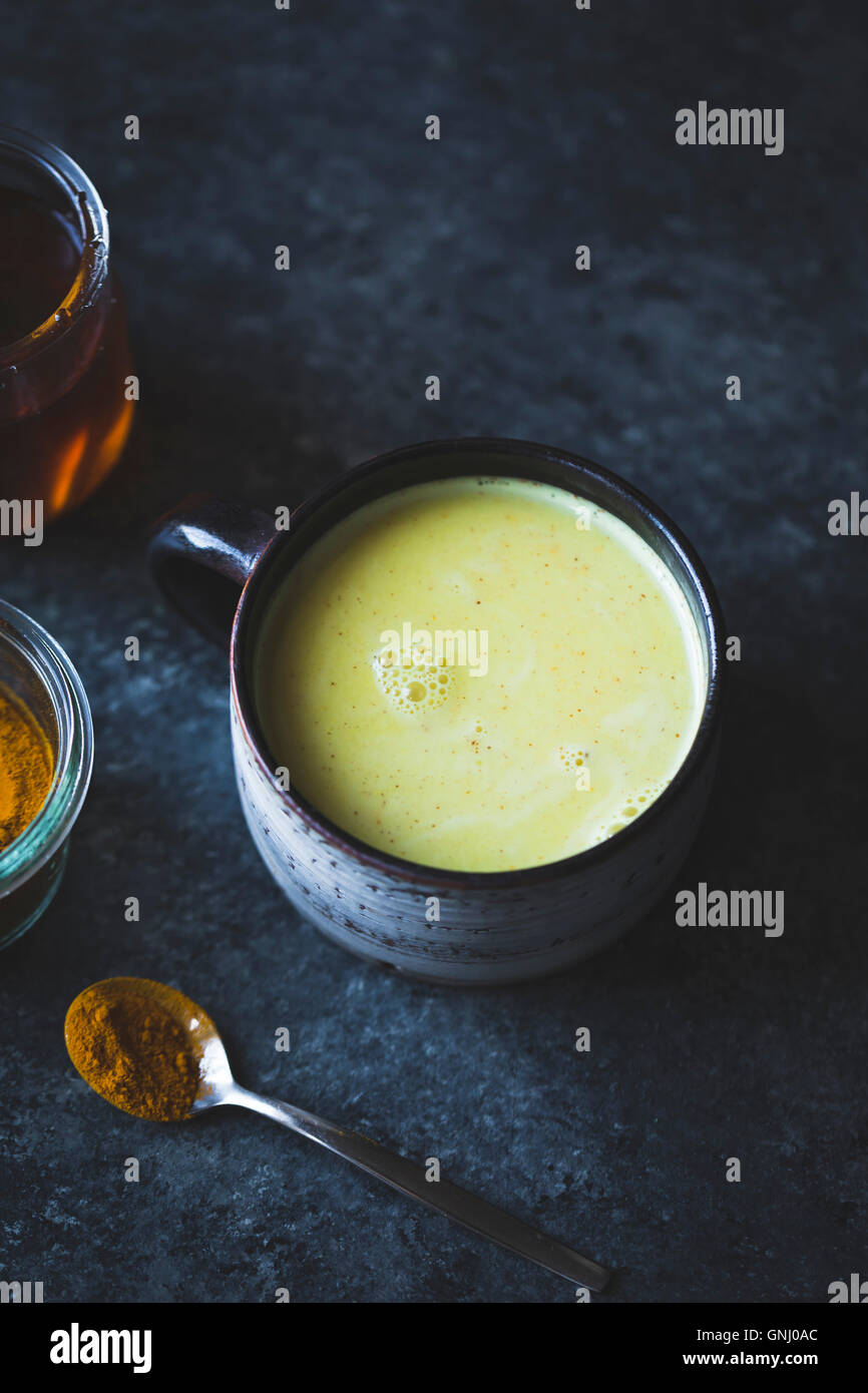 Golden Milk - Mixed honey, turmeric, ginger, cardamom, and cinnamon Stock Photo