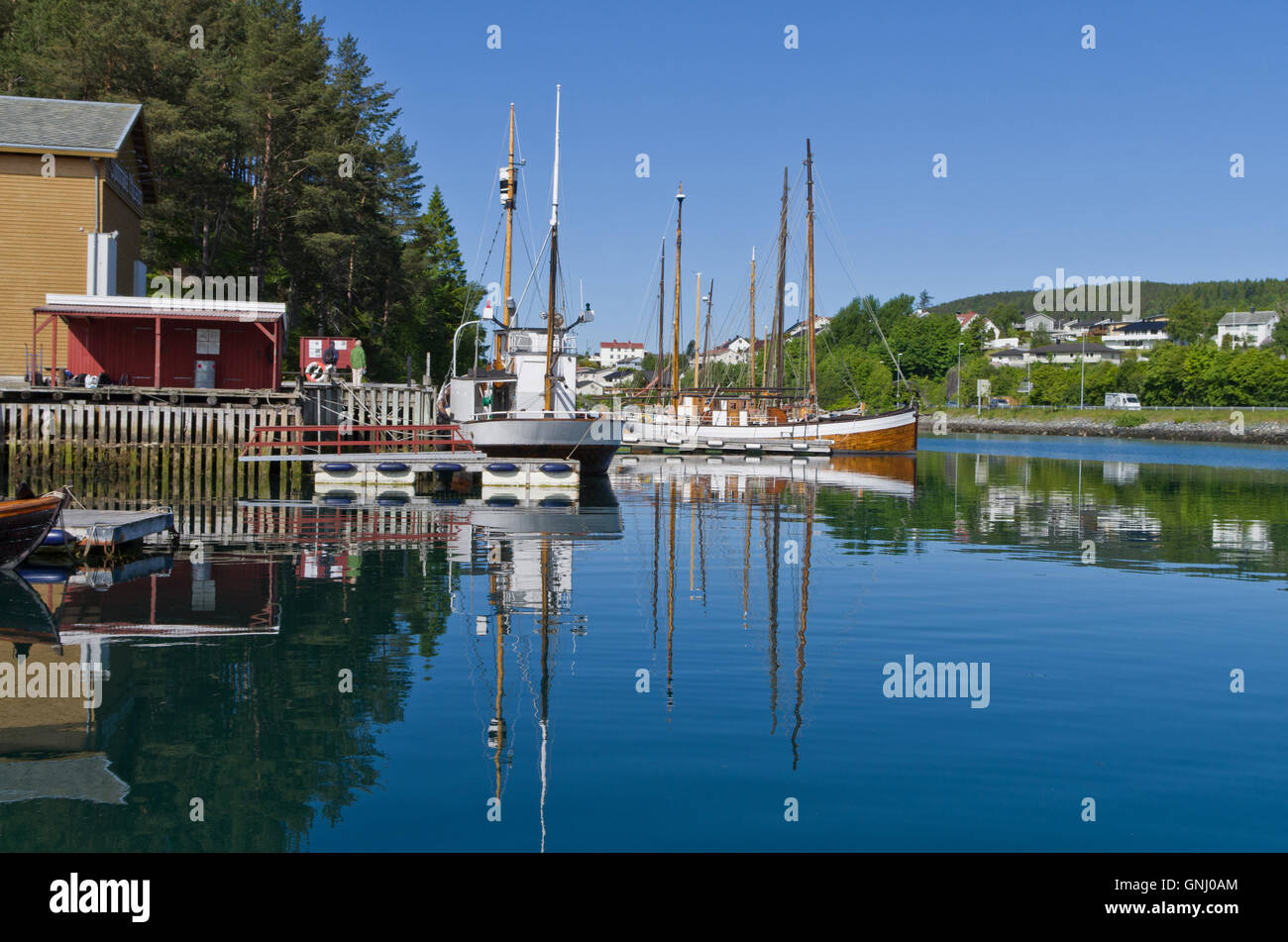 Old classic masted boats on the lake at Sunnmore Museum, Alesund, Norway - Stock Image