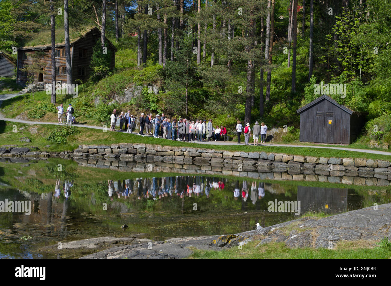 A party of visitors on a guided tour of Sunnmore Museum, Alesund, Norway - Stock Image