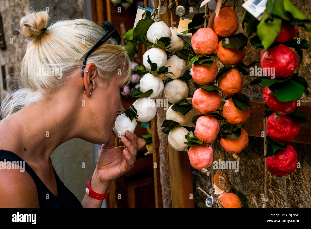 Girl smelling handmade soap in italy tuscany - Stock Image