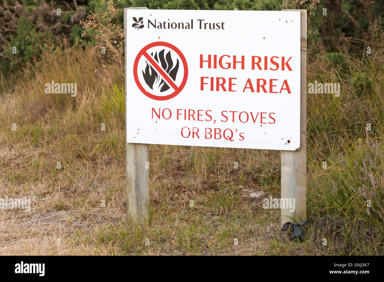 National Trust high risk fire area no fires stoves or BBQs sign along side of road at Studland, Dorset in August - Stock Image