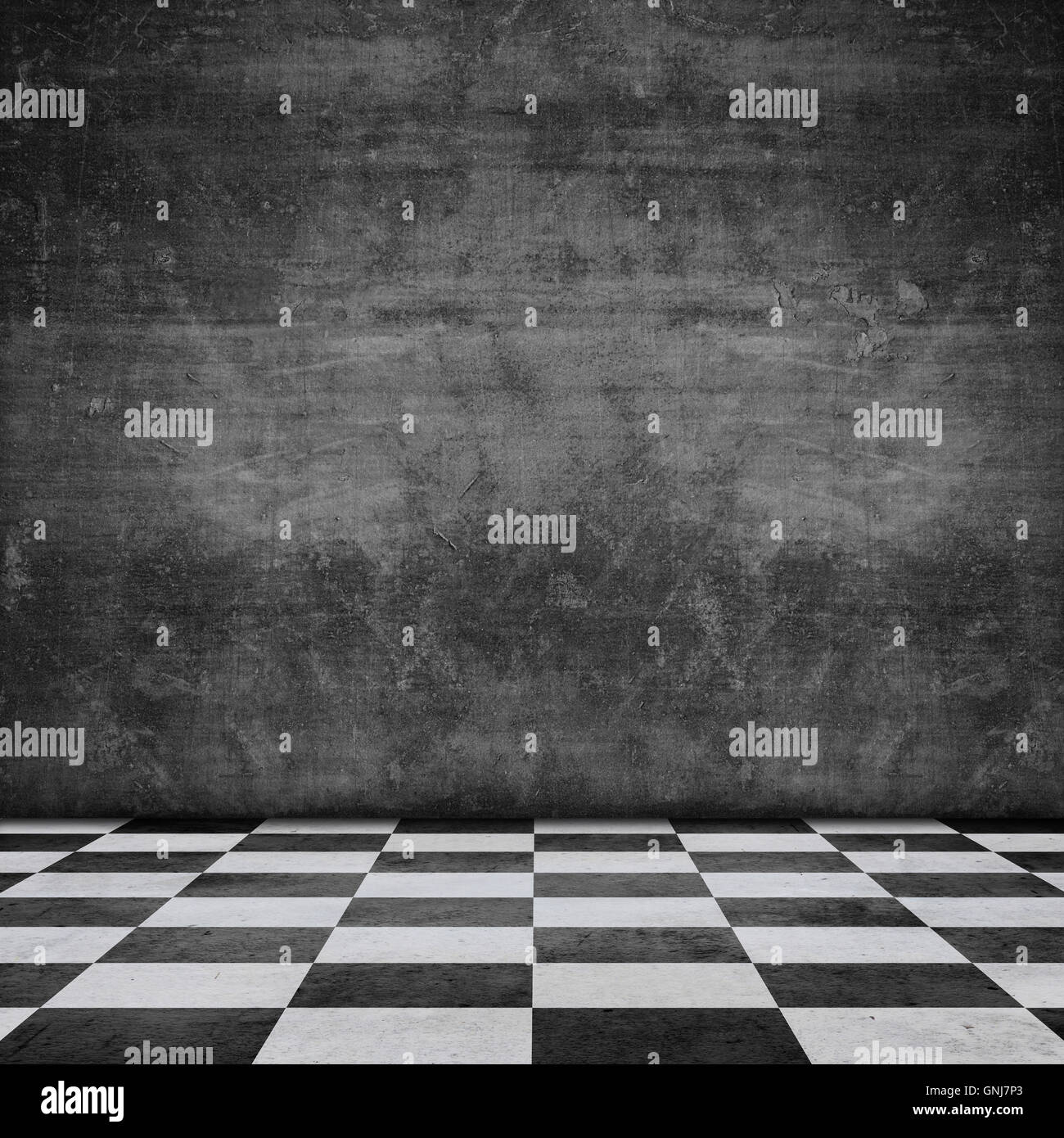 old scratched black wall chequered pattern floor, stage - Stock Image