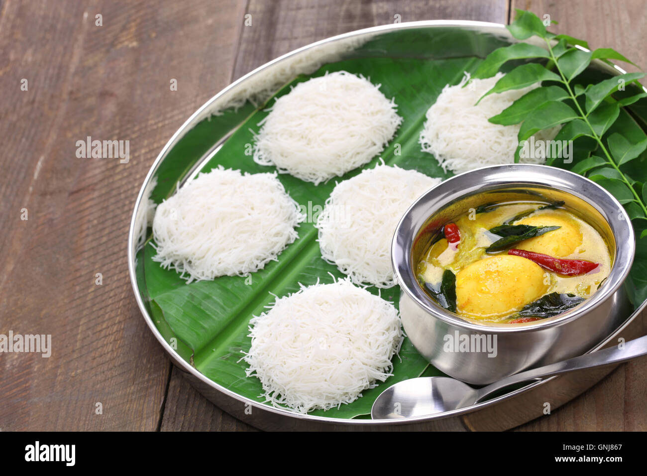 idiyappam (string hoppers)  with egg curry, south indian and sri lankan cuisine - Stock Image