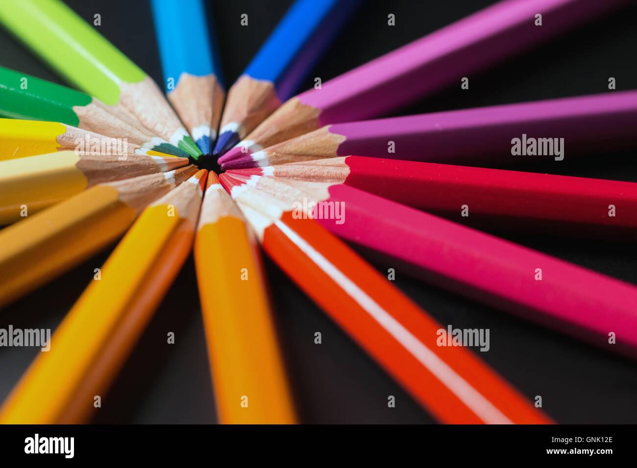 Color pencils in arrange in color wheel. Assortment of colored pencils. - Stock Image