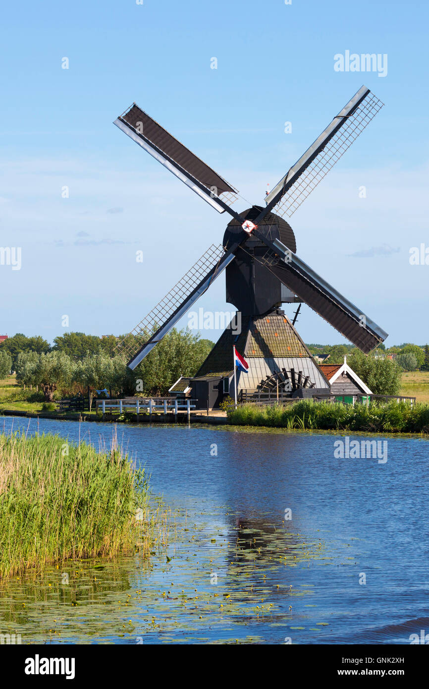 Authentic working windmill at Kinderdijk UNESCO World Heritage Site, dykes and polder, Holland, The Netherlands - Stock Image