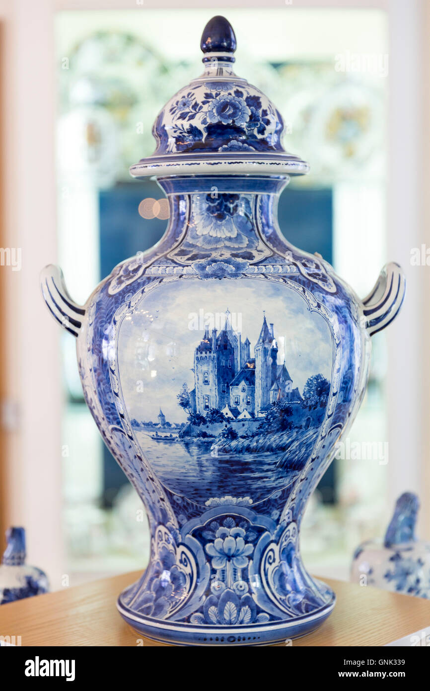 Delft Blue luxury old hand-painted porcelain urn vase at Royal Delft Experience shop in Amsterdam, Holland - Stock Image
