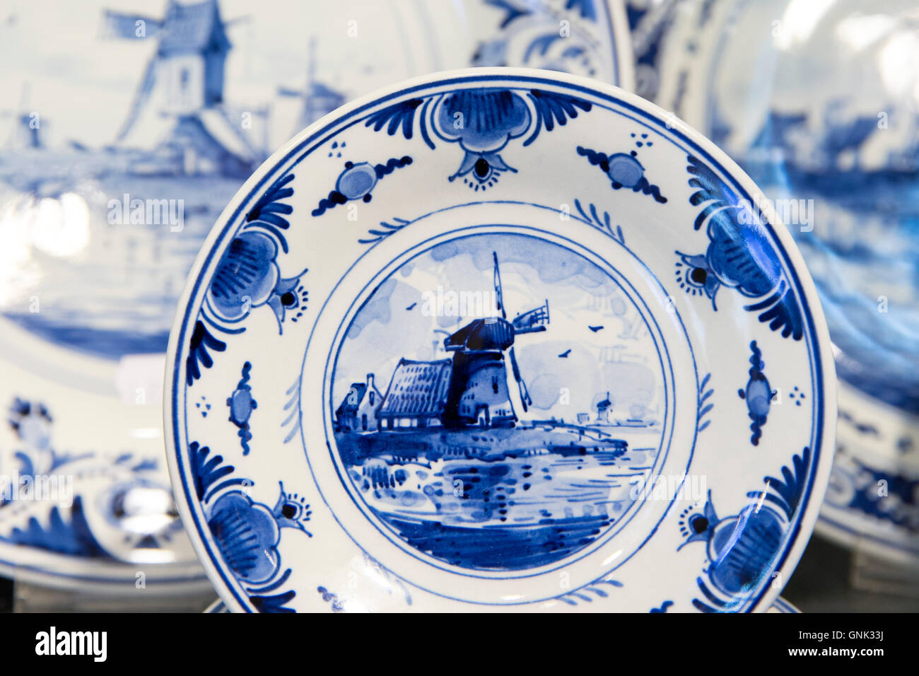 Delft Blue luxury items - traditional porcelain windmill plates - in Royal Delft Experience shop in Amsterdam Holland & Delft Blue luxury items - traditional porcelain windmill plates - in ...