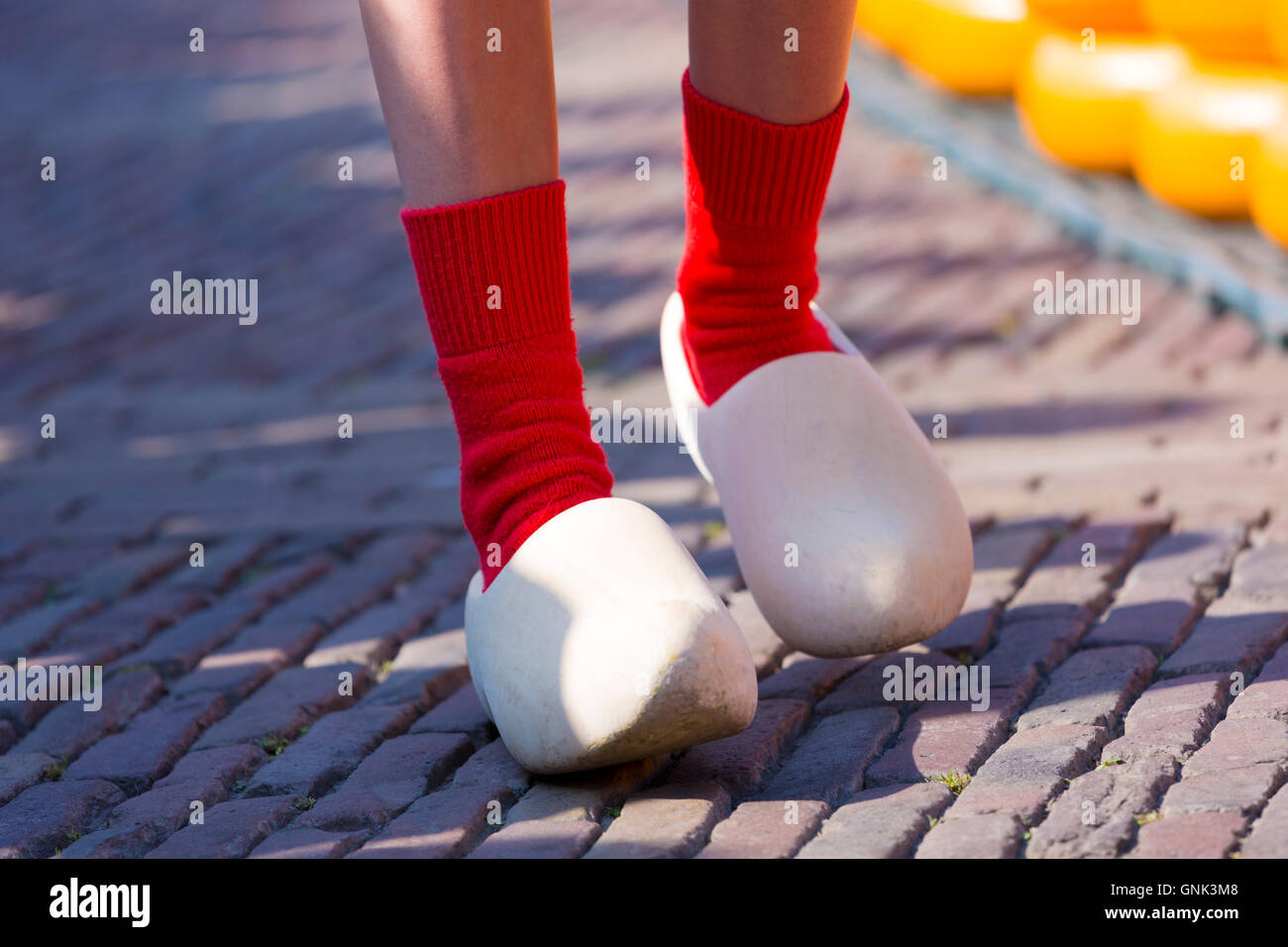 Dutch clogs traditional shoes and socks worn by woman Kaasmeisje, Alkmaar cheese market, The Netherlands - Stock Image