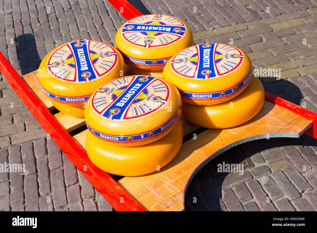 Display of wheels of Beemster aged gourmet Gouda cheese at Alkmaar cheese market, The Netherlands - Stock Image