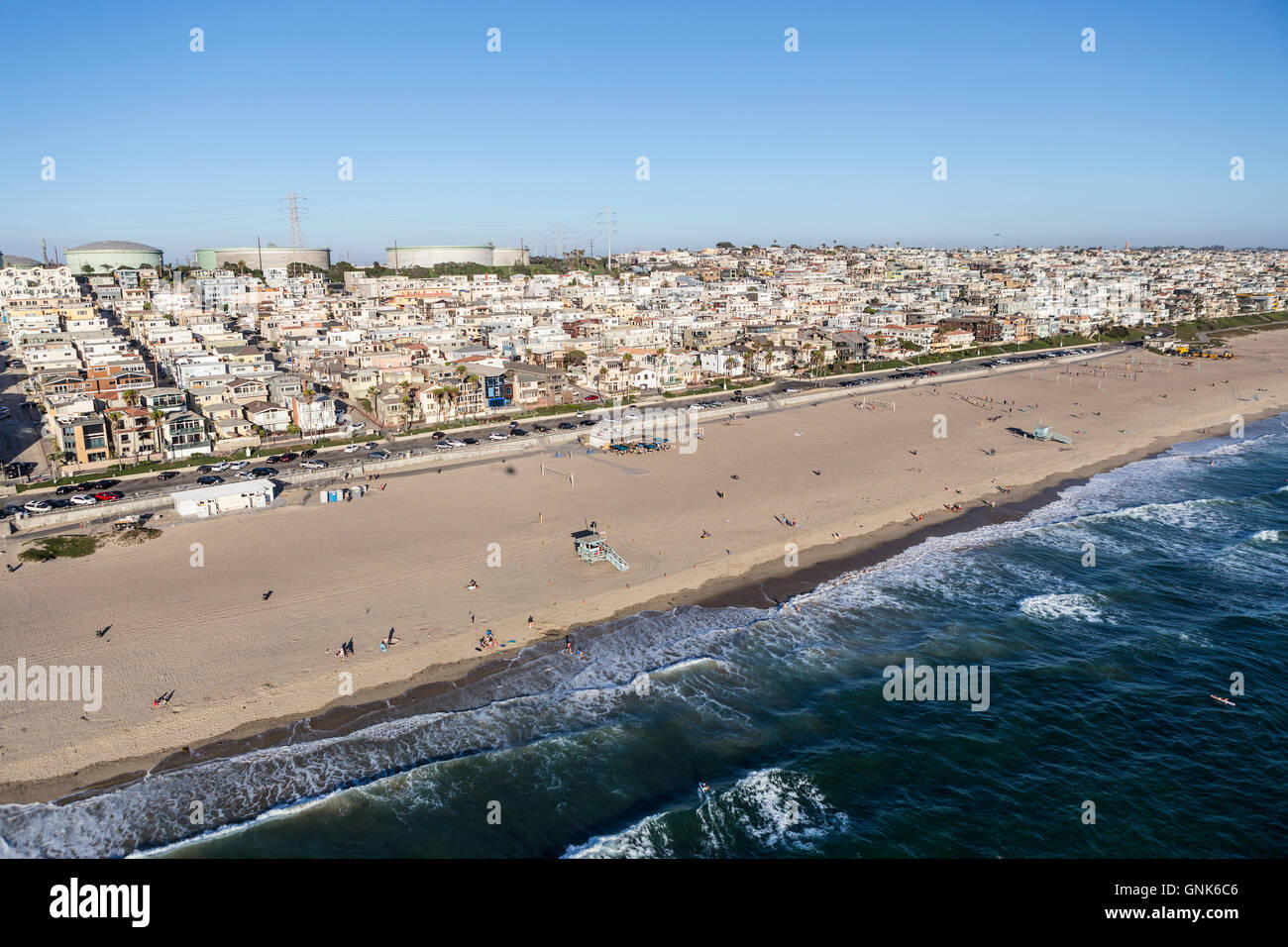 Afternoon aerial view of broad sandy beaches and layers of housing in Manhattan Beach, near Los Angeles, California. - Stock Image