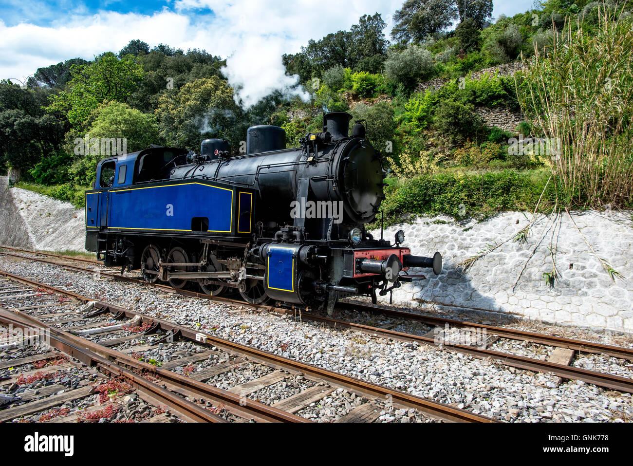 steam engine vintage retro historical working rail tracks tourist attraction France - Stock Image