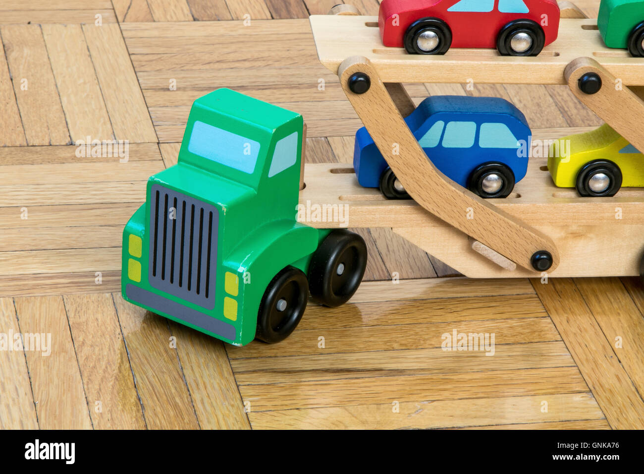 A toy truck carrying toy cars Stock Photo
