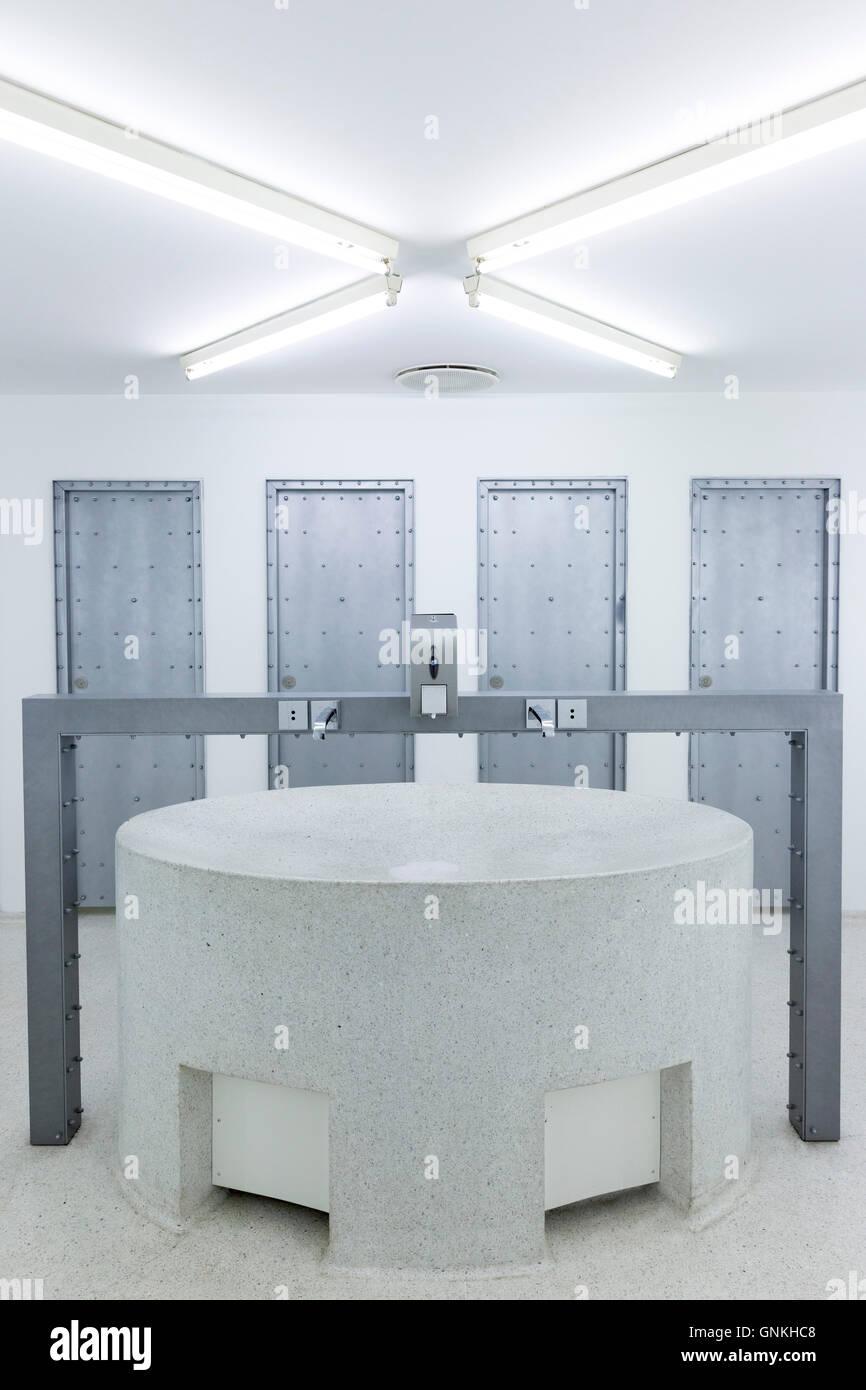 Minimalist Modern Gents Lavatory Toilets And Wash Basin At