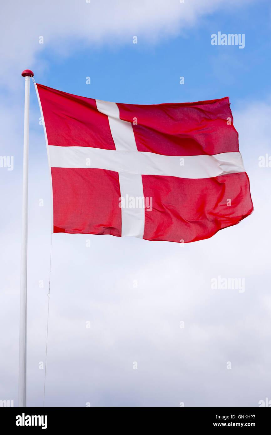 Danish flag on flagpole in Denmark - Stock Image