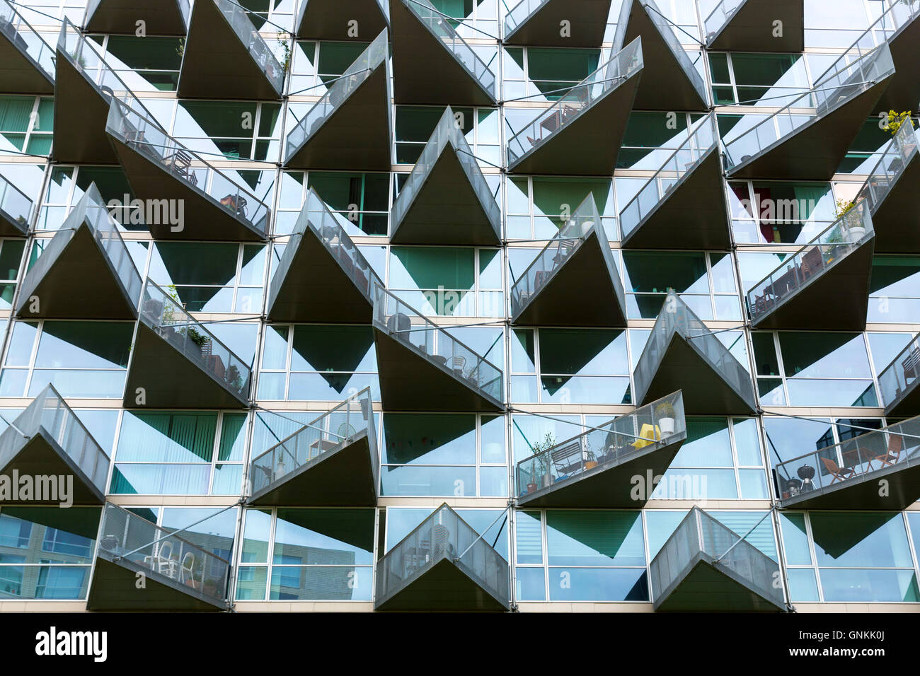 Glass balcony modern architecture new high rise homes development Orestads Boulevard in Orestad City area, Copenhagen, Stock Photo