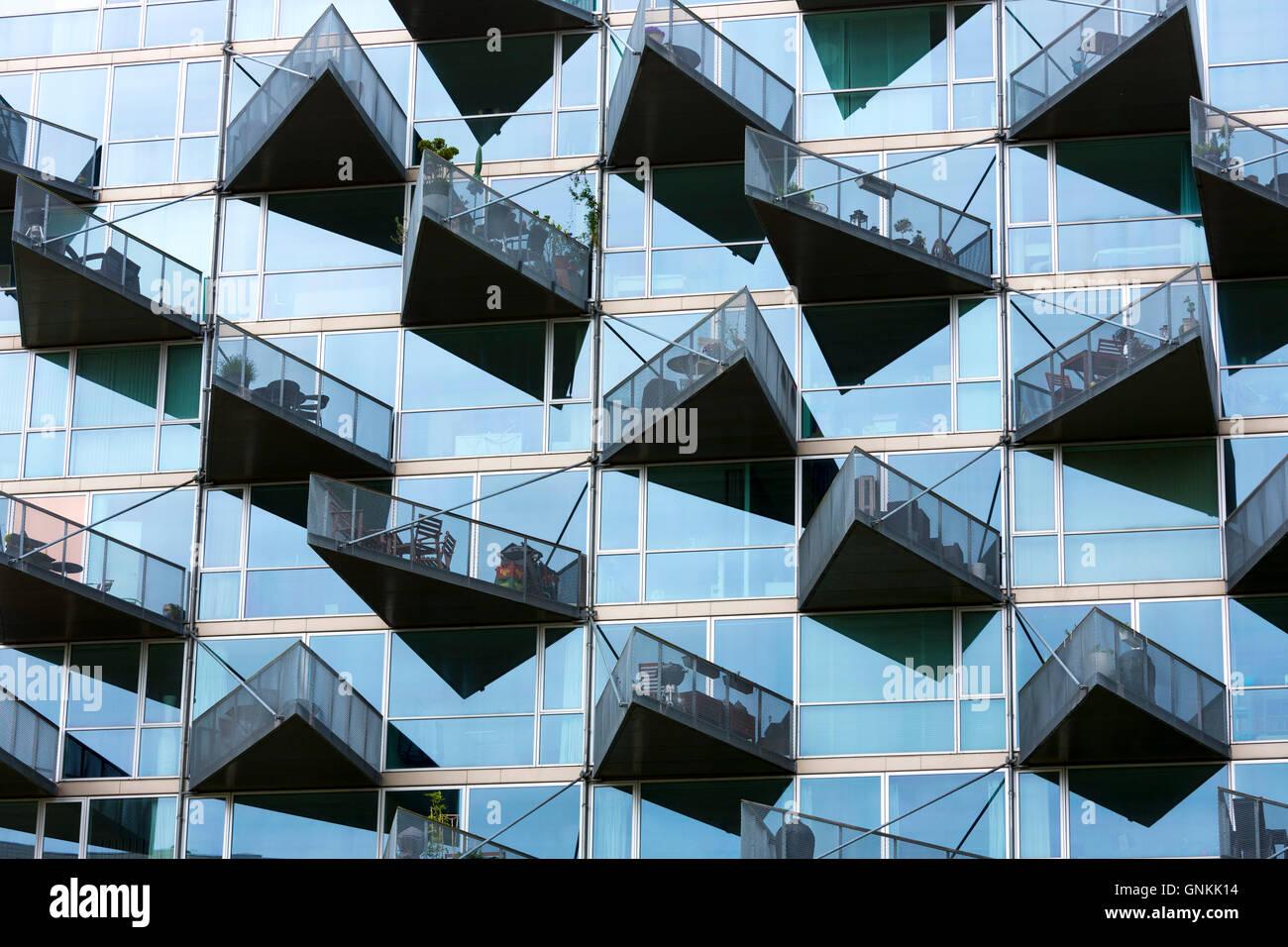 Glass balcony modern architecture new high rise homes development Orestads Boulevard in Orestad City area, Copenhagen, Stock Photo