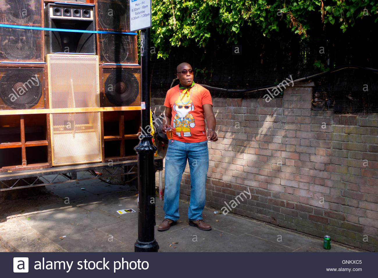 Man dances to sound system at the 50th Notting Hill Carnival, London, August 29 2016. - Stock Image