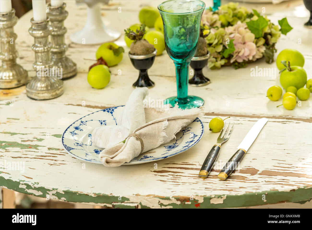 Image of rustic dinner table setting. - Stock Image