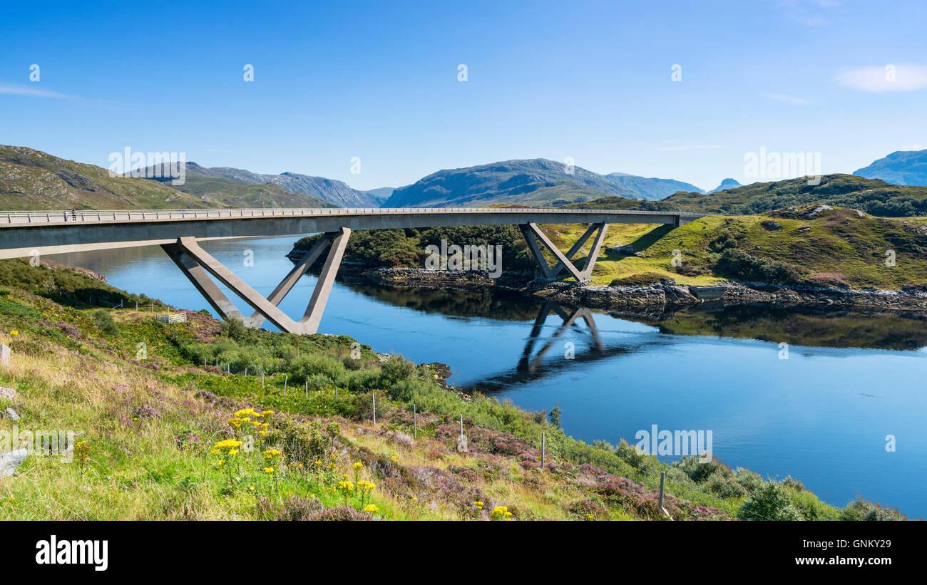 View of Kylesku Bridge on North Coast 500 tourist route in Sutherland, Highland, Scotland , United Kingdom, - Stock Image
