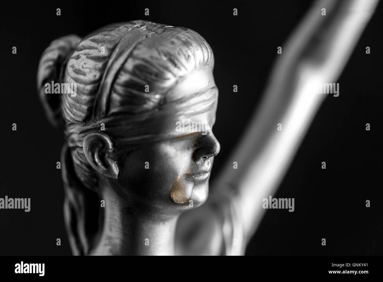 Lady justice is crying - Stock Image