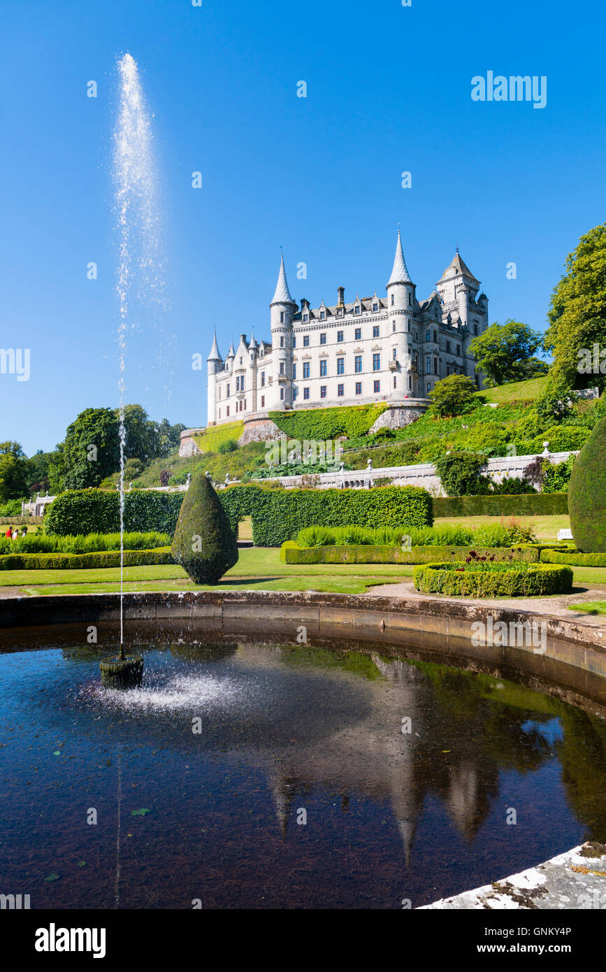 Dunrobin Castle with pond and gardens at Golspie, Highland, Scotland. Castle is seat of the Earl of Sutherland and - Stock Image
