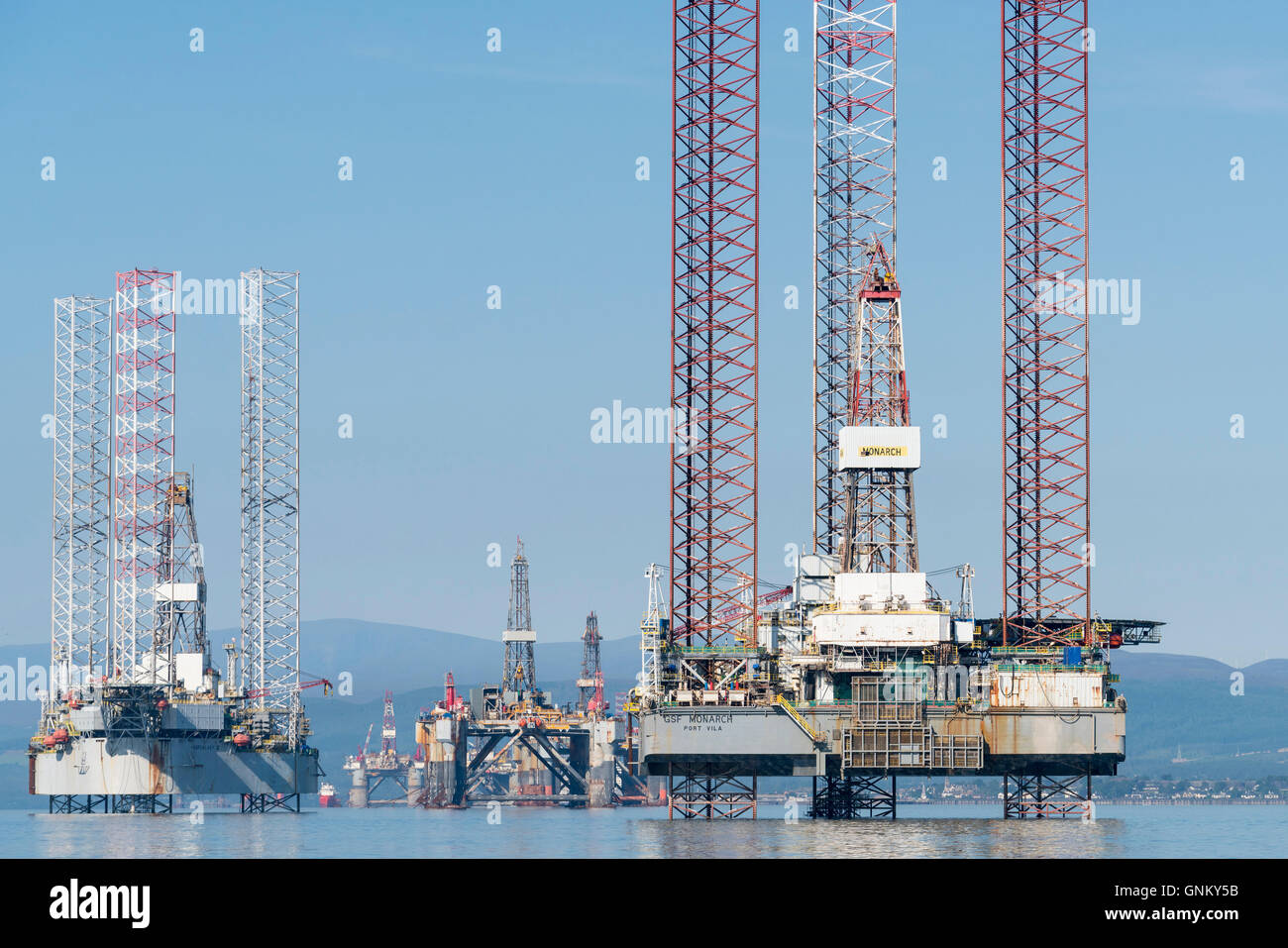 Oil rigs / drilling platforms moored in Cromarty Firth in Ross and Cromarty, Highland, Scotland, United Kingdom Stock Photo