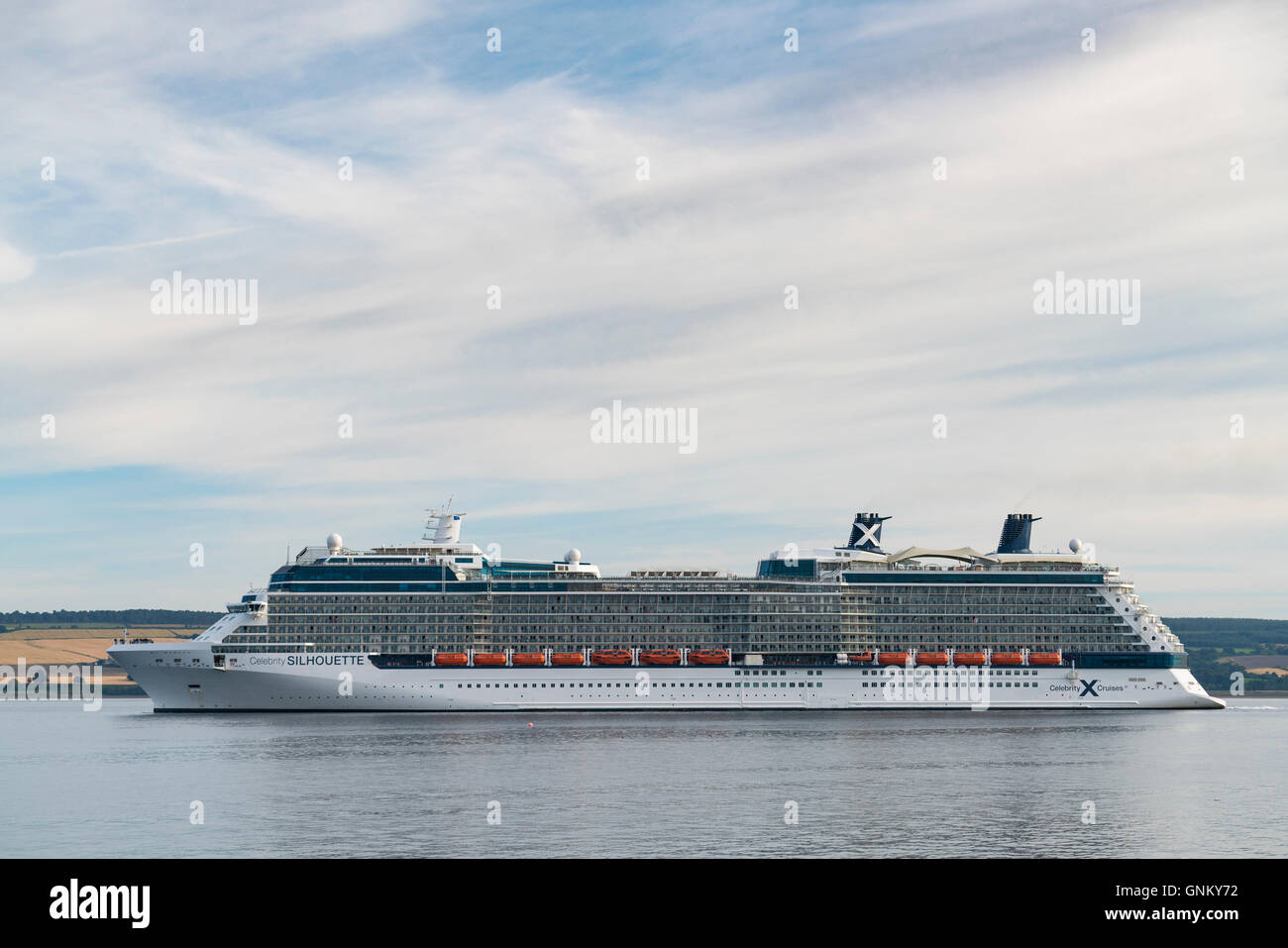 Luxury cruise liner Celebrity Silhouette leaving port of Invergordon in Ross and Cromarty,Highland, Scotland, United - Stock Image