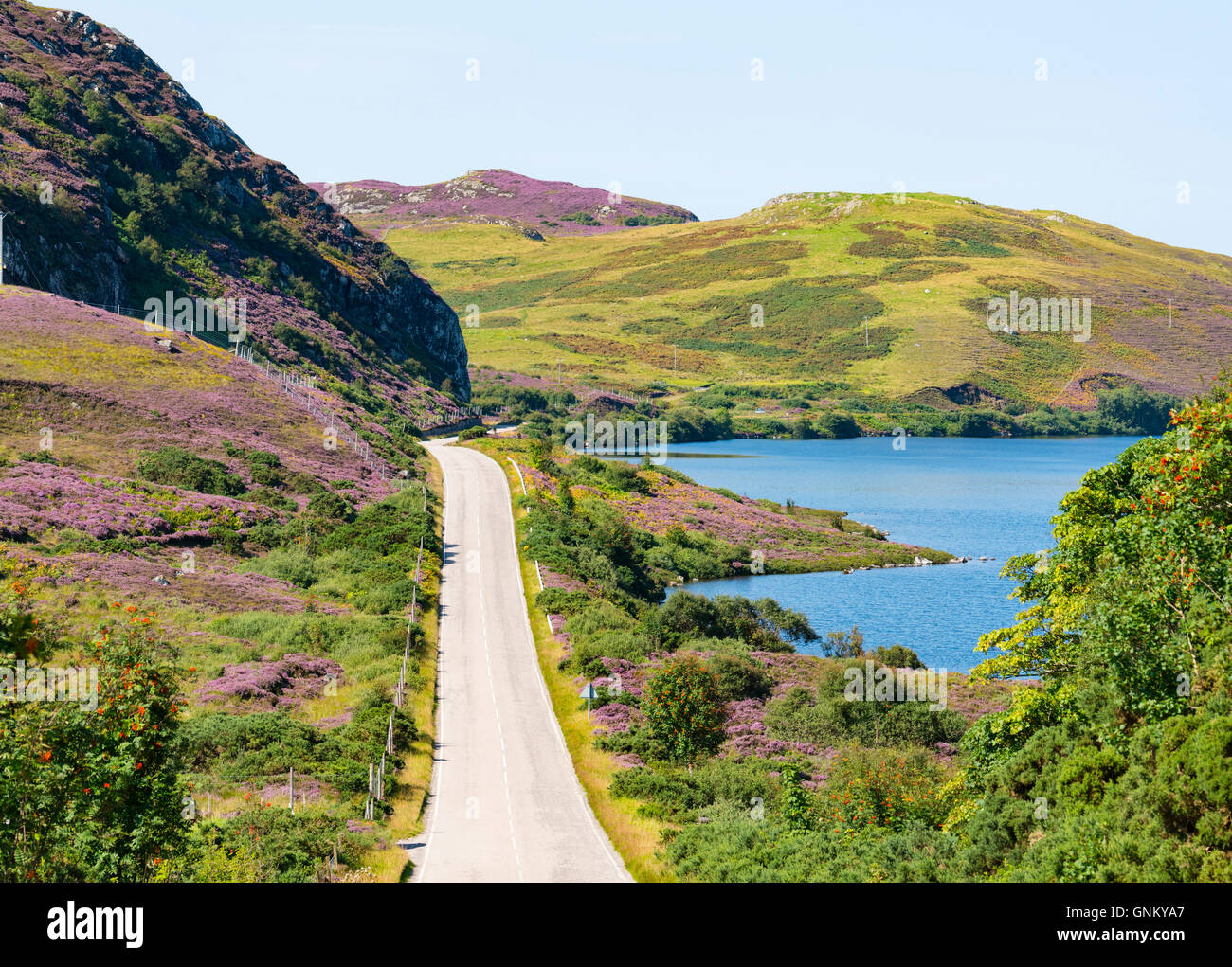 Remote highway A894 part of North Coast 500 tourist route, in Highland Region, near Scourie north Scotland in summer,United Stock Photo