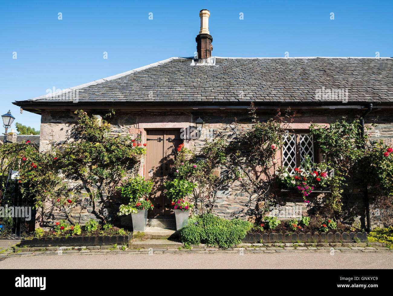 Traditional old cottages in historic village of Luss on banks of Loch Loomnd, in Argyll and Bute, Scotland, United - Stock Image