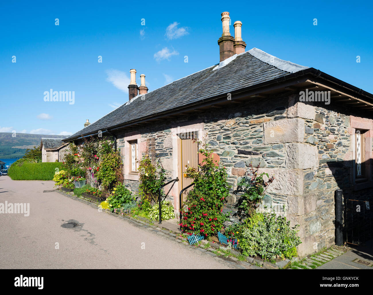 Traditional old cottages in historic village of Luss on banks of Loch Lomond, in Argyll and Bute, Scotland, United - Stock Image