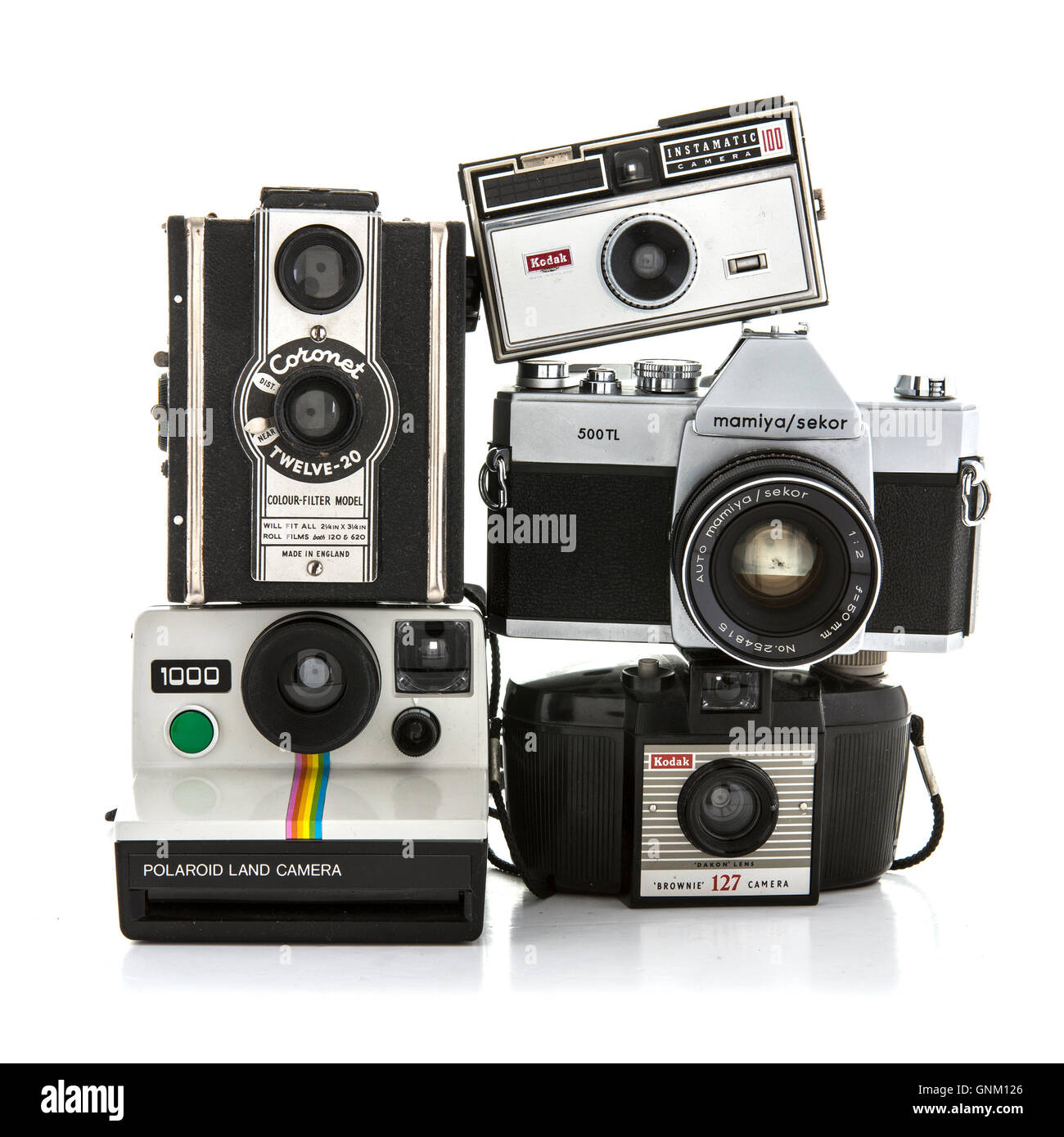 Collection of old cameras on a white background - Stock Image