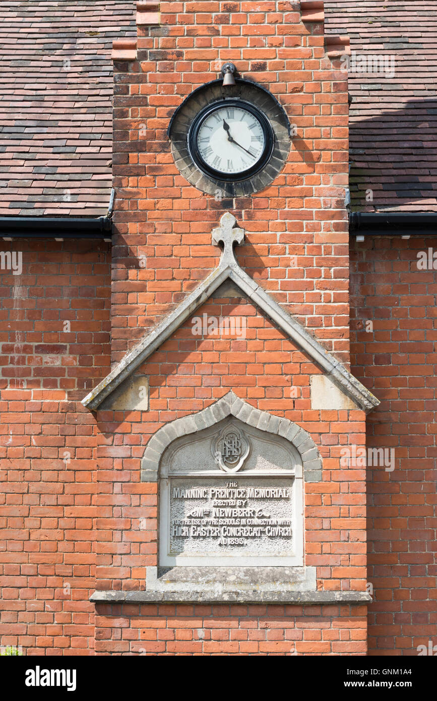 The Manning Prentice Memmorial and clock on a red brick building at High Easter Essex UK - Stock Image