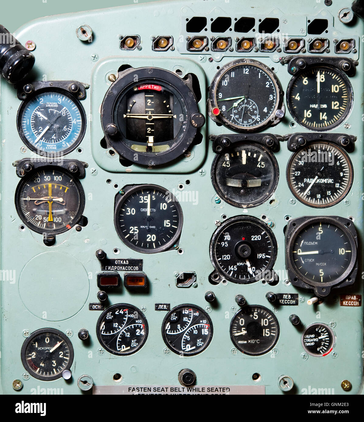 Detail of a airplane cockpit with various indicators and buttons - Stock Image