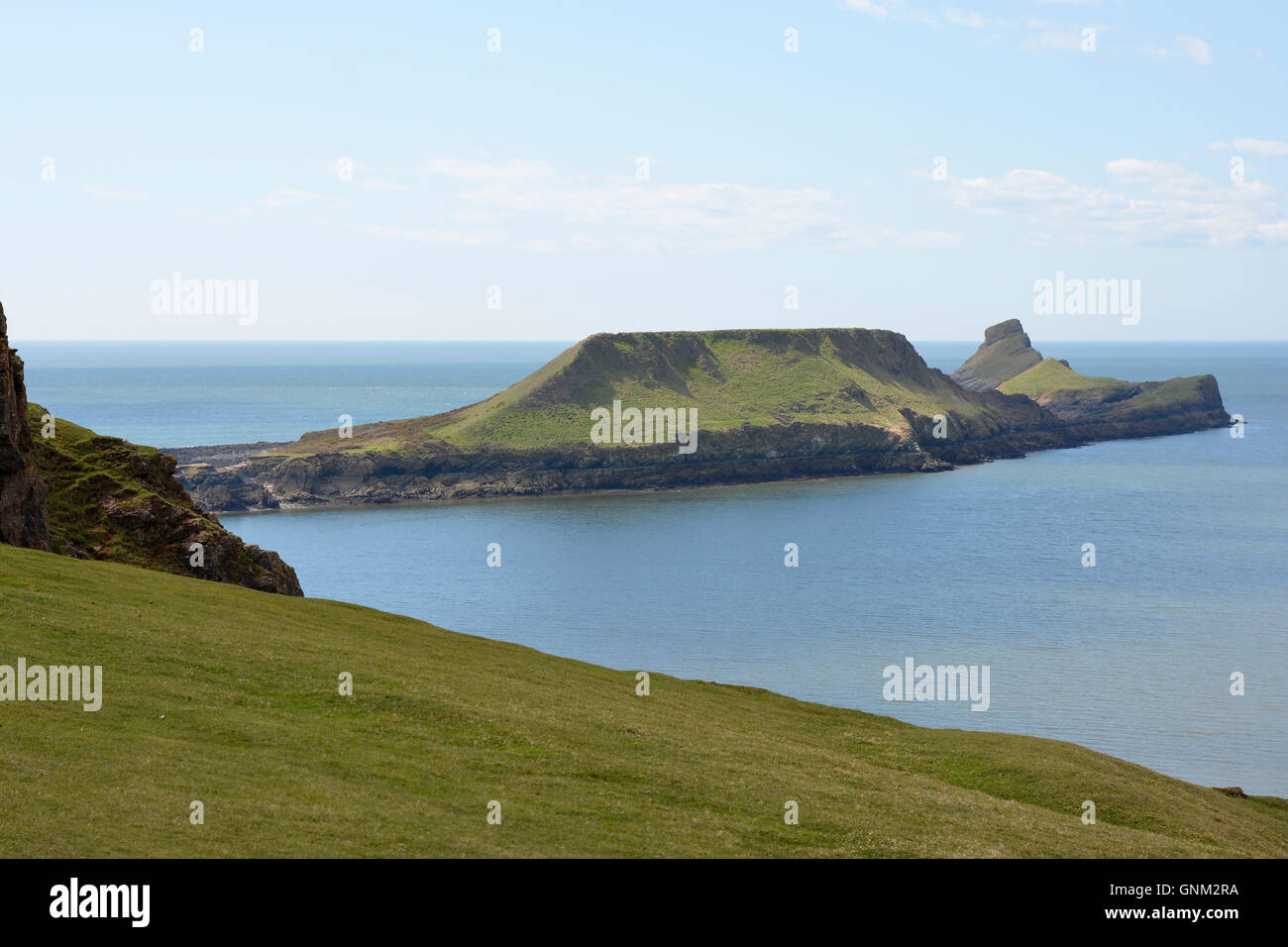 View to Worms Head or Penrhyn-gwyr on the Gower Peninsular at Rhossili in Wales, United Kingdom - Stock Image