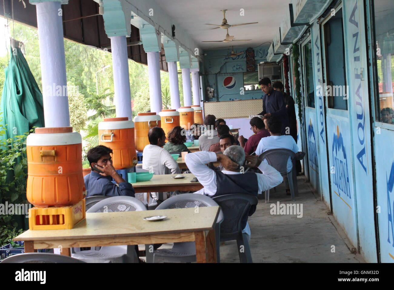 A photograph of a tribal area in Pakistan of a low end hotel that serves tea and food to customers who are traveling Stock Photo