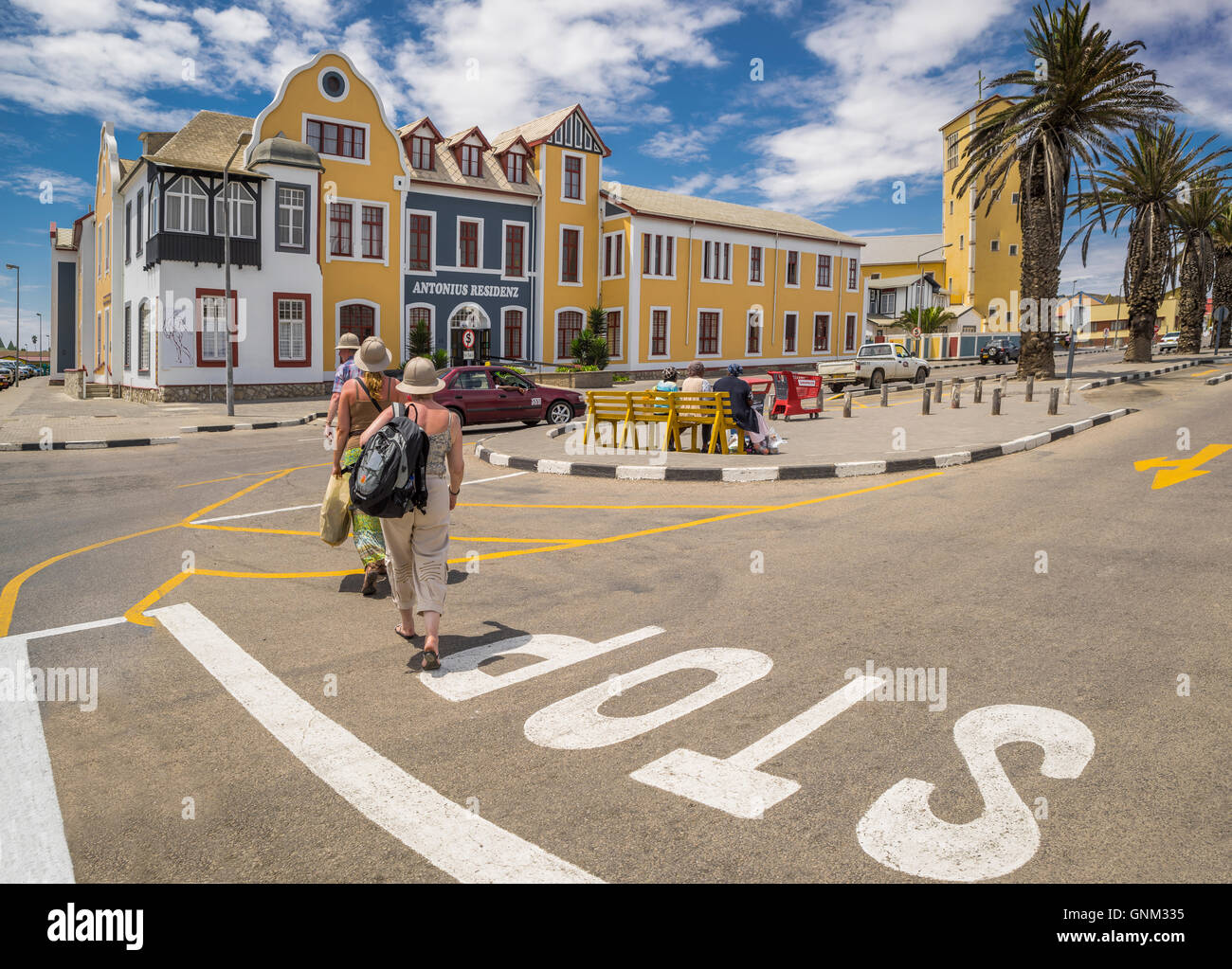 Tourists crossing the street in Walvis Bay, Namibia, Africa - Stock Image