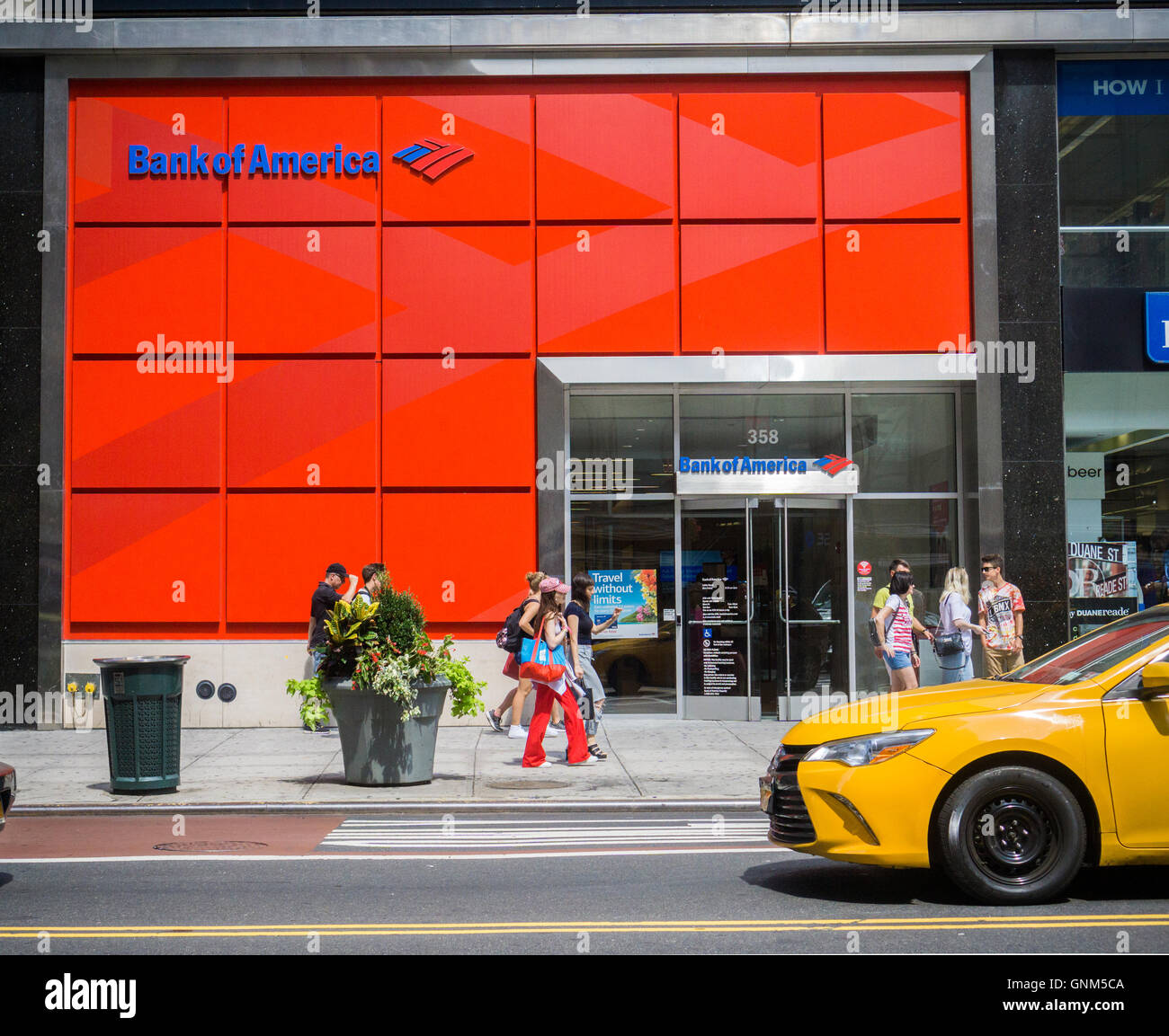 A bright red branch of Bank of America in New York on Friday, August 26, 2016. (© Richard B. Levine) - Stock Image
