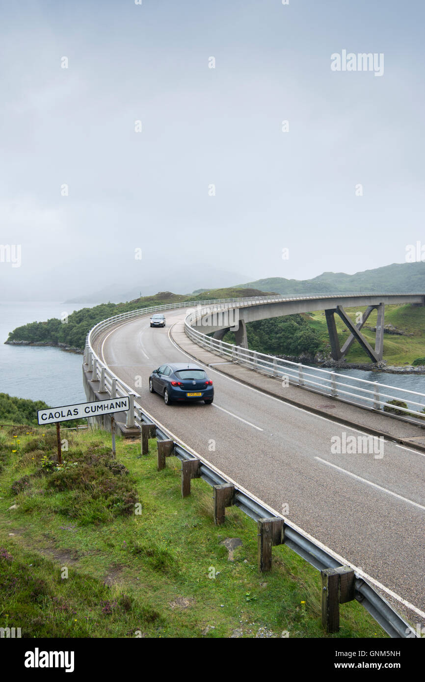 Traffic on Kylesku Bridge across the Loch a Chairn Bhain in Sutherland, Scotland, part of the North Coast 500 scenic - Stock Image