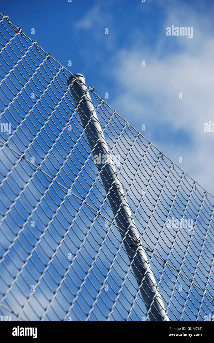 Wire security fencing an pole against the sky Stock Photo: 116614704 ...