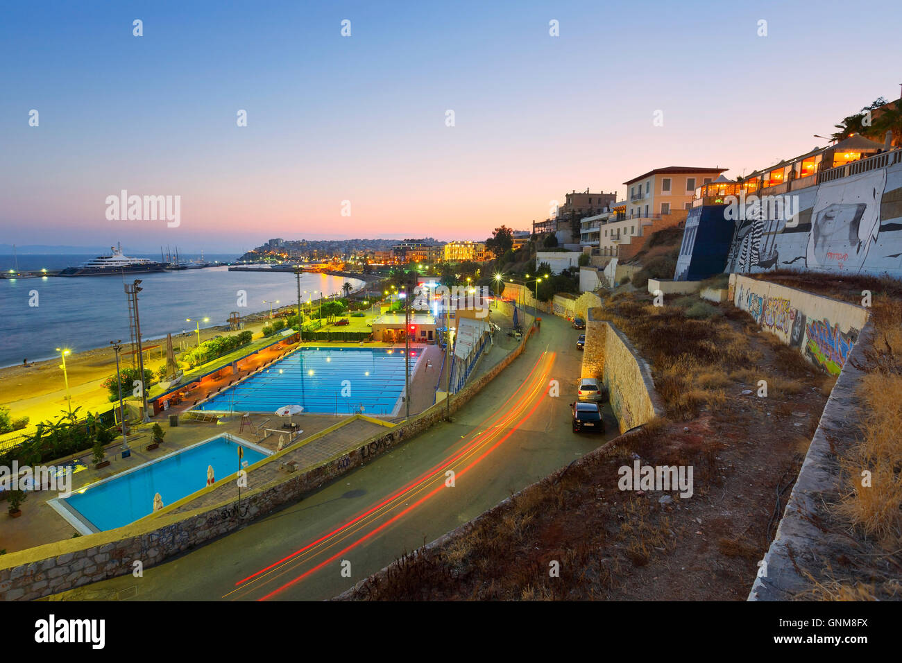 View of the municipal swimming pool in Piraeus and mouth of Zea marina, Athens. - Stock Image