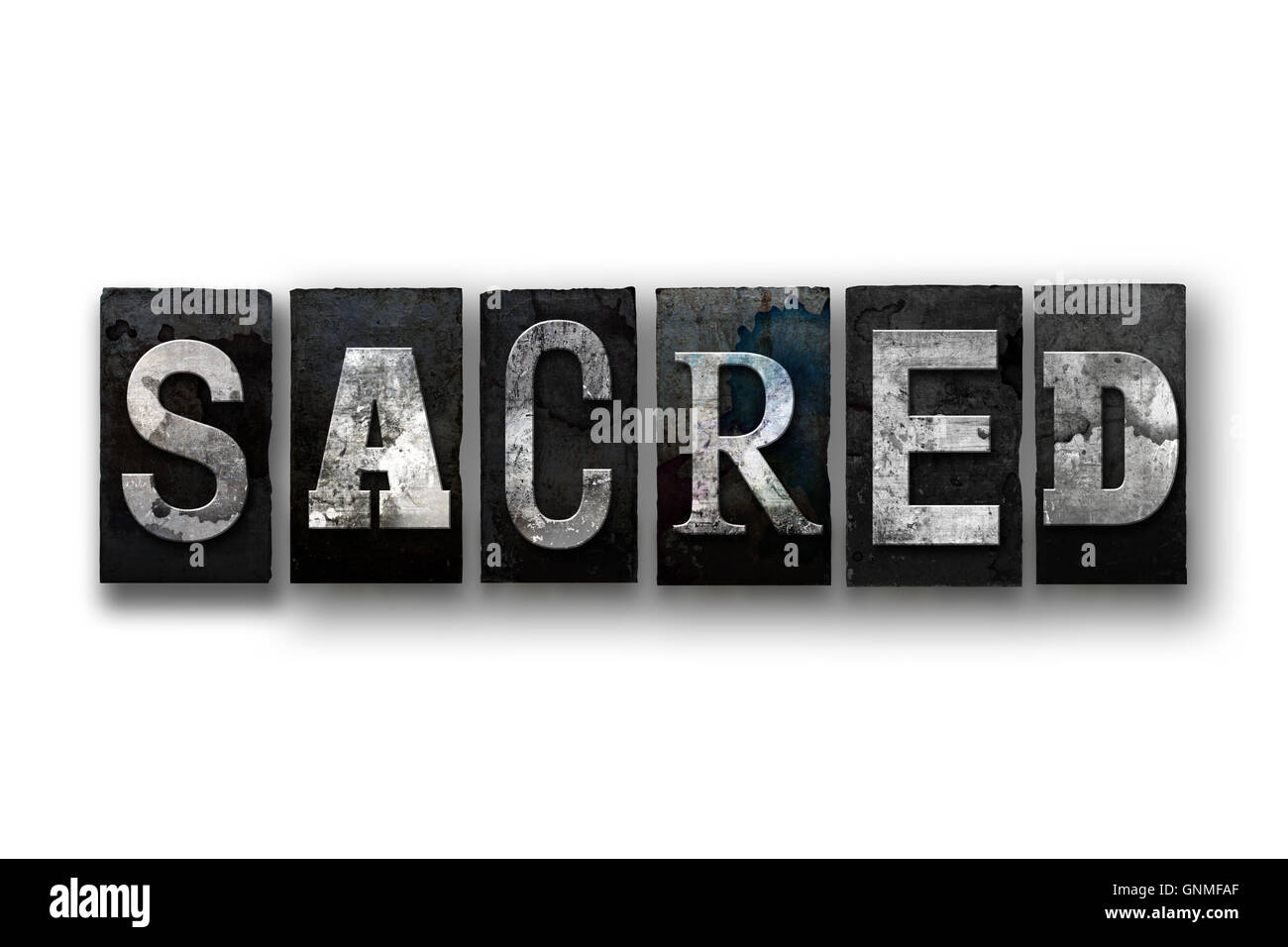 The word 'SACRED' written in vintage, dirty, ink stained letterpress type and isolated on a white background. - Stock Image