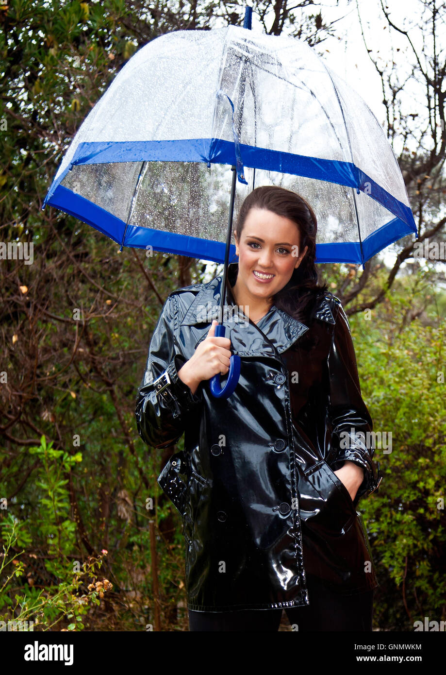 Attractive Young Woman Dressed For Wet Weather In Shiny