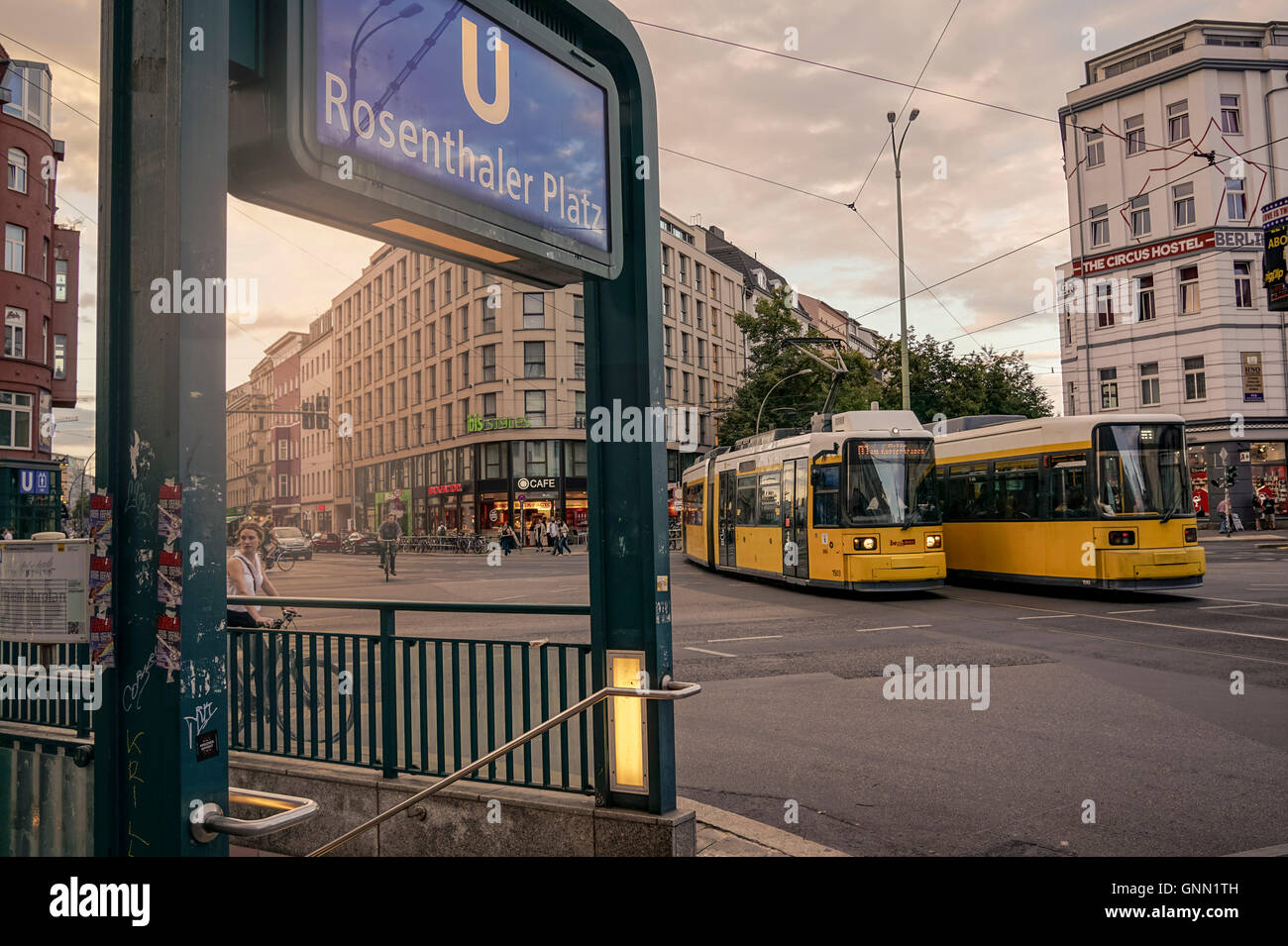 Intersection Rosenthaler Platz with two tram trains meeting each other at sunset Stock Photo